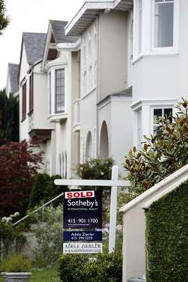 A for sale sign marked sold hangs outside a house in the Seacliff district of San Francisco, California, on Wednesday, August 15, 2007. San Francisco Bay Area home sales fell to their lowest level in 12 years in July as potential buyers waited for pricesto decline in a restricted mortgage market. The median price rose 4 percent, matching a record set in June. Photographer: Erin Lubin/Bloomberg News.