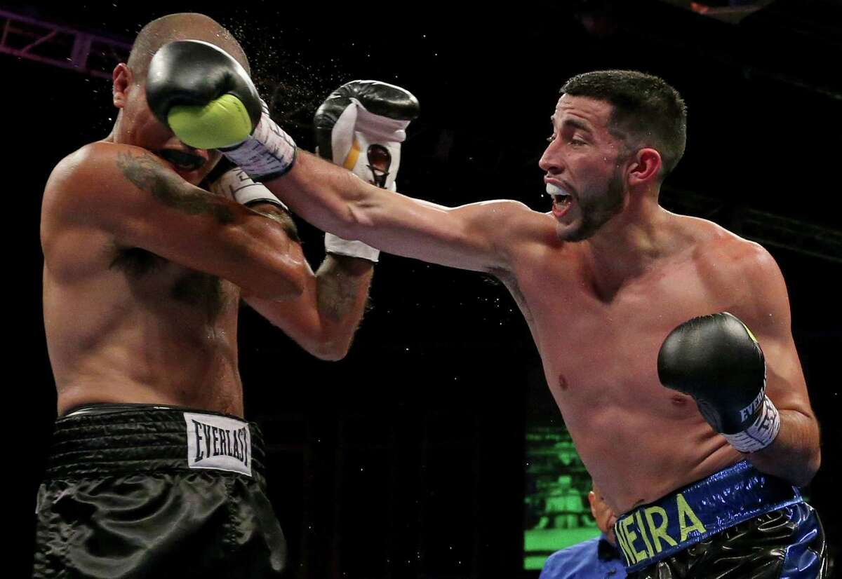 San Antonio's Enrique Neira (left) lands a right hand against Rudy Lozan during their bout May 28, 2016 at Cowboys Dancehall.
