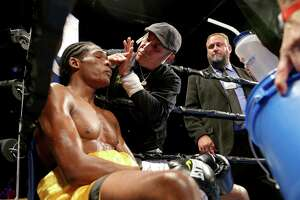 Boxing cutman Joe Villanueva (center) applies Vaseline to boxer Xavier Wilson during his fight with Anthony Hill Saturday May 28, 2016 at Cowboys Dancehall. Wilson won by unanimous decision.