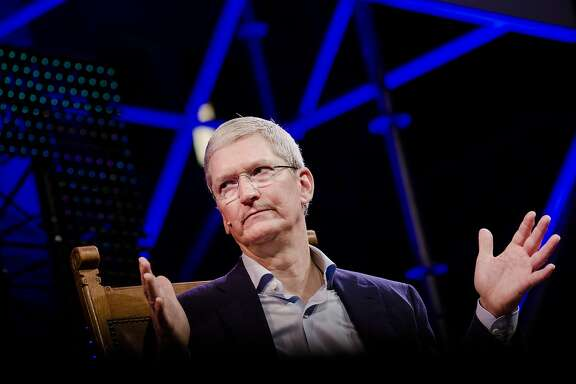 "Tim Cook, chief executive officer of Apple Inc., gestures during the opening of ""Startup Fest"", a five-day conference to showcase Dutch innovation, in Amsterdam, Netherlands, on Tuesday, May 24, 2016. The Digital City Index for 2015 ranked Amsterdam Europe's second-best city, behind London, for tech startups. Photographer: Marlene Awaad/Bloomberg *** Local Caption *** Tim Cook"