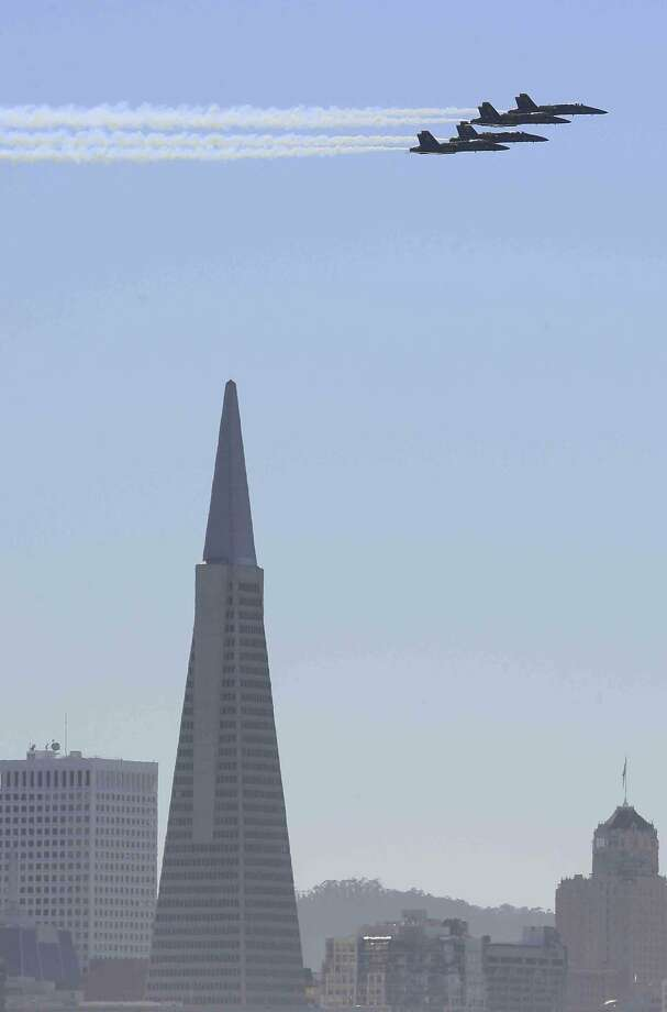 The U.S. Navy Blue Angels fly over the Transamerica Pyramid during a Fleet Week air show Sunday, October 12, 2014 Photo: Jessica Christian, The Chronicle