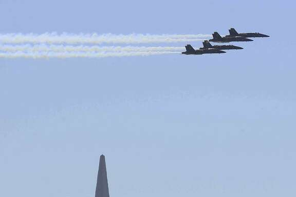 The U.S. Navy Blue Angels fly over the Transamerica Building during a Fleet Week air show Sunday, October 12, 2014