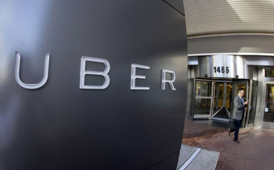 FILE - In this Dec. 16, 2014, file photo a man leaves the headquarters of Uber in San Francisco. Uber said Wednesday, June 1, 2016, that it is getting a massive cash infusion from Saudi Arabia. (AP Photo/Eric Risberg, File) Photo: Eric Risberg, Associated Press