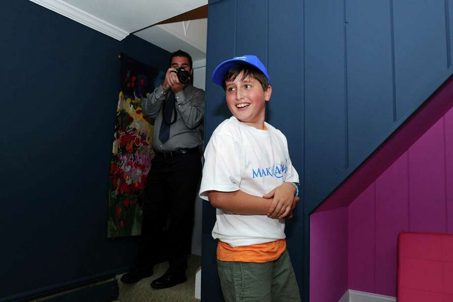 Eli Schwartz, 8, of Stamford, smiles as we walks into his new man cave for the first time. Photo: Michael Cummo / Hearst Connecticut Media / Stamford Advocate