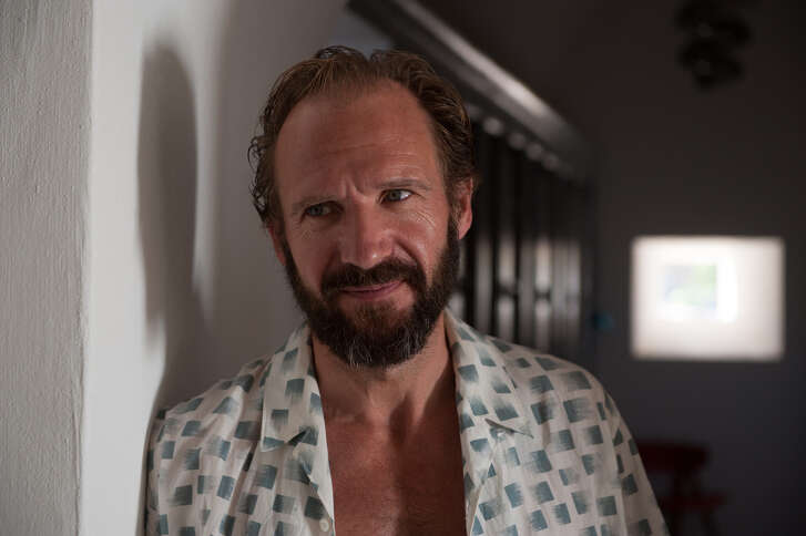 In an undated image, the actor Ralph Fiennes in a scene from A Bigger Splash. Sometimes, a movie succeeds as much because of its style as its story, and Fiennes' character has a bag of designer clothes to show off, including one distinctive white, green and gray short-sleeve shirt from Christophe Lemaire that he wears while dancing around to the Rolling Stones Emotional Rescue.