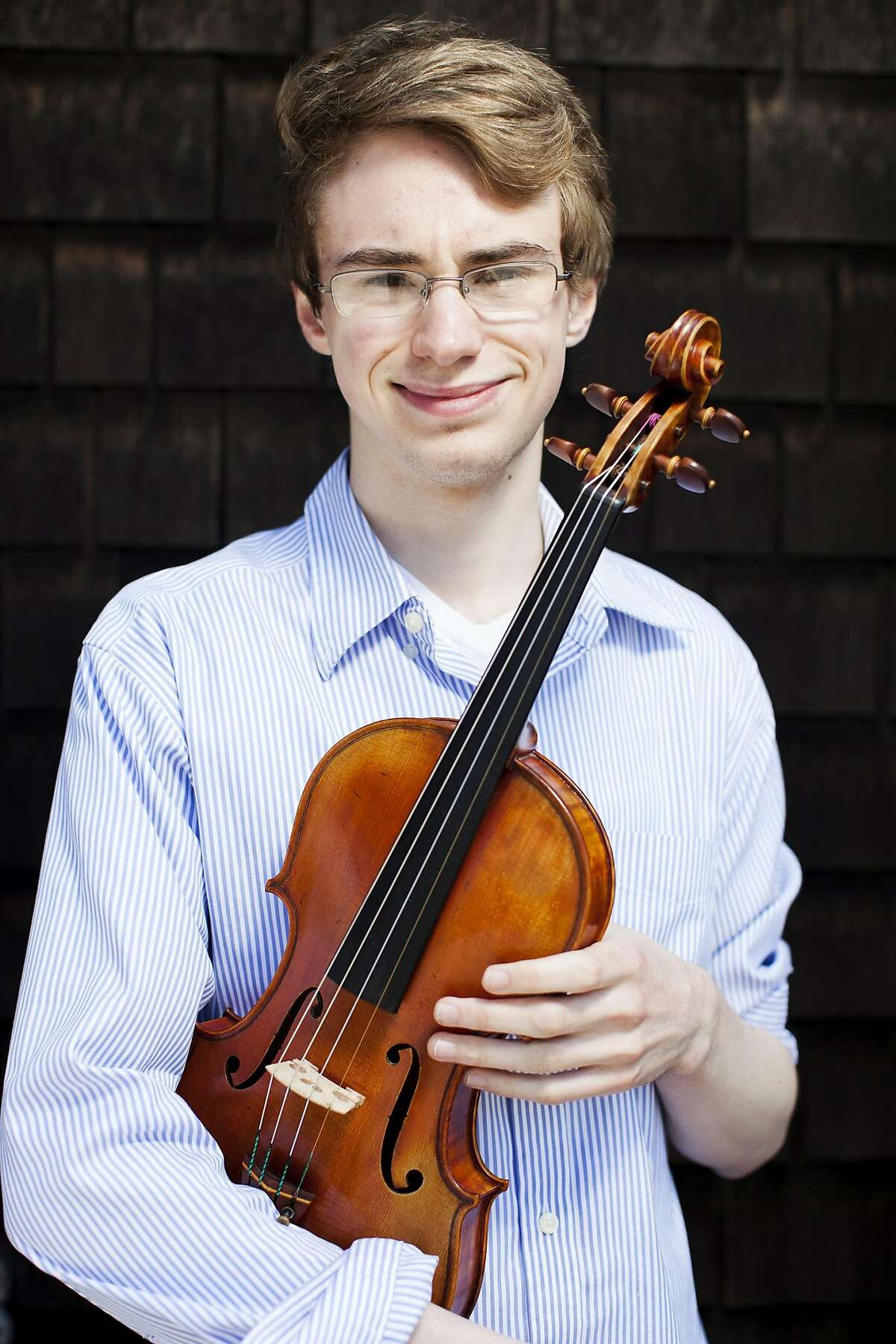 18 year-old violinist Kenneth Renshaw sits for a portrait at home in San Francisco, Calif. on Thursday, May 24, 2012. Renshaw, who has been playing violin since the age of 4, has won first prize in the senior division of the prestigious Menuhin Competition in Beijing this April. The former concertmaster of the San Francisco Symphony Youth Orchestra has also recently graduated from The Ruth Asawa San Francisco School of the Arts and is planning to attend the New England Conservatory of Music in Boston this fall.