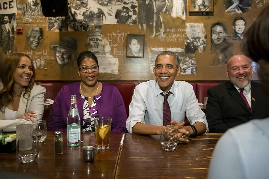 President Obama meets with ex-prisoners whose sentences had been commuted in Washington D.C. He has granted the greatest number of commutations for a single month of any president. Photo: ZACH GIBSON, NYT