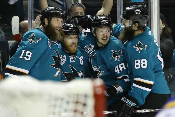 SAN JOSE, CA - MAY 25:  Joe Pavelski #8 of the San Jose Sharks celebrates his goal against the St. Louis Blues with Joe Thornton #19, Brent Burns #88 and Tomas Hertl #48 in Game Six of the Western Conference Final during the 2016 NHL Stanley Cup Playoffs at SAP Center on May 25, 2016 in San Jose, California.  (Photo by Ezra Shaw/Getty Images)