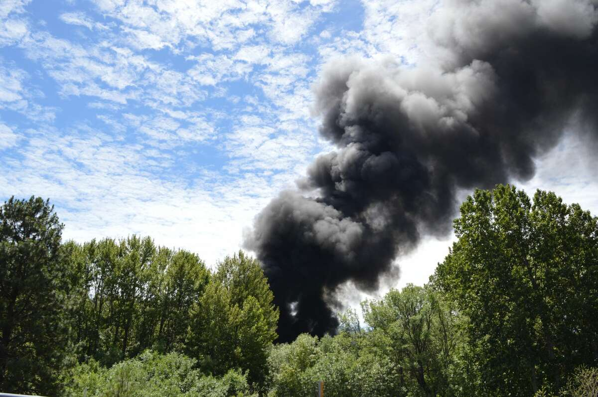 A fire burning in the Columbia River Gorge National Scenic Area after 14 cars of a Union Pacific oil train derailed and four caught fire on Friday, June 3, 2016. The environmental advocacy group Columbia Riverkeeper provided this photo of the blaze near Mosier, Oregon.