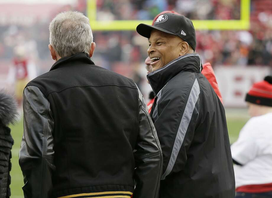 Ronnie Lott, here with fellow Hall of Famer Joe Montana at a 49ers game, is leading a predominantly African American investment group that wants to help build a new stadium for the Raiders in Oakland. Photo: Eric Risberg, Associated Press