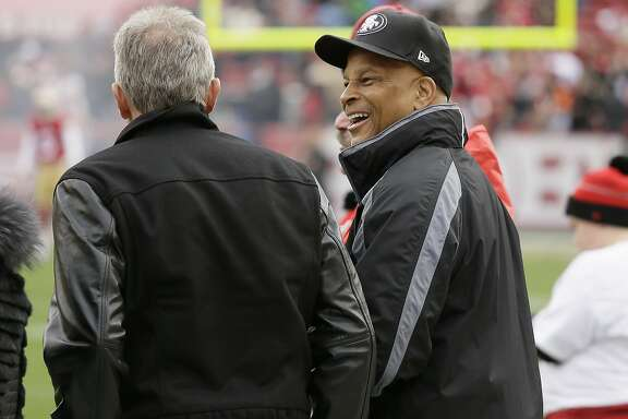Former San Francisco 49ers players Joe Montana, left, and Ronnie Lott talk before an NFL football game between the San Francisco 49ers and the Cincinnati Bengals in Santa Clara, Calif., Sunday, Dec. 20, 2015. (AP Photo/Jeff Chiu)