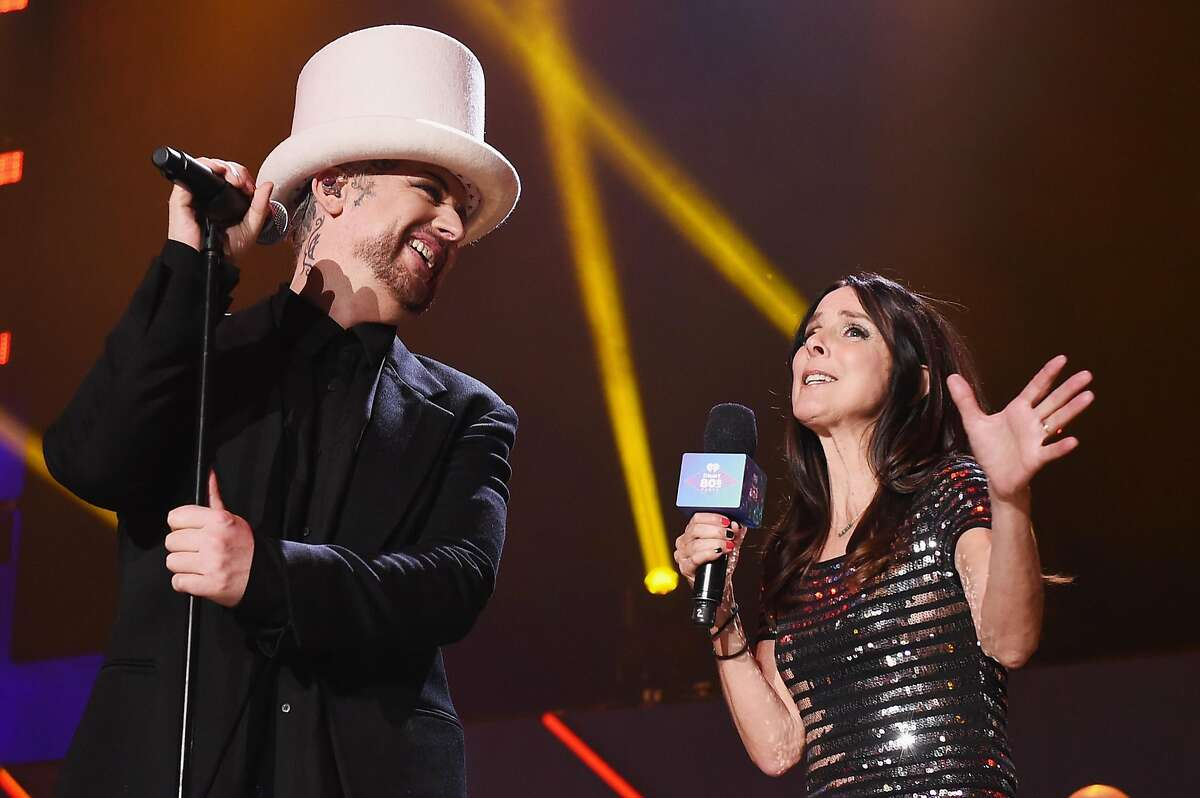 INGLEWOOD, CA - FEBRUARY 20: Recording artist Boy George (L) of music group Culture Club and TV personality Martha Quinn speak onstage during the first ever iHeart80s Party at The Forum on February 20, 2016 in Inglewood, California. (Photo by Kevin Winter/Getty Images for iHeartMedia)
