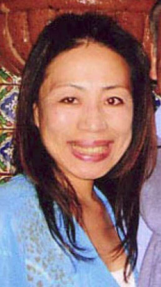 Michiko Kamhi, 48, of Florence Road in Greenwich, was reported missing since Monday night, police said Wednesday. Kamhi, who is described as a 5-foot-4, 118-pound Asian woman with black shoulder-length hair, was last seen leaving her Greenwich home driving a gray 2002 Volvo V70 wagon with the family dog, a white mixed golden doodle. Photo courtesy of the Greenwich Police Department. Photo: Contributed Photo / Greenwich Time Contributed
