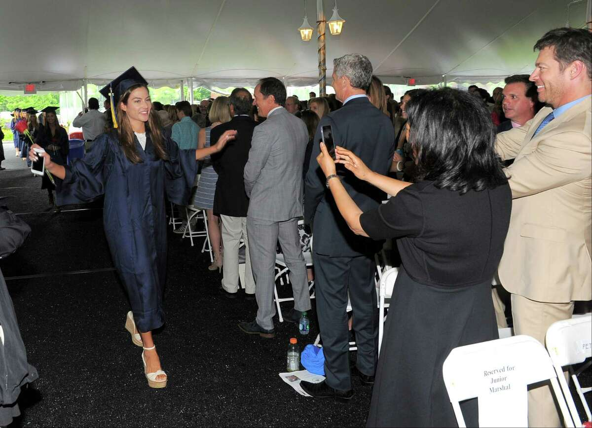 Kate Connick, at left, gleefully poses for her father Harry Conninck Jr., at right, and family as the 2016 graduates of King School celebrated commencement at their campus in Stamford, Conn., on Friday, June 3, 2016.