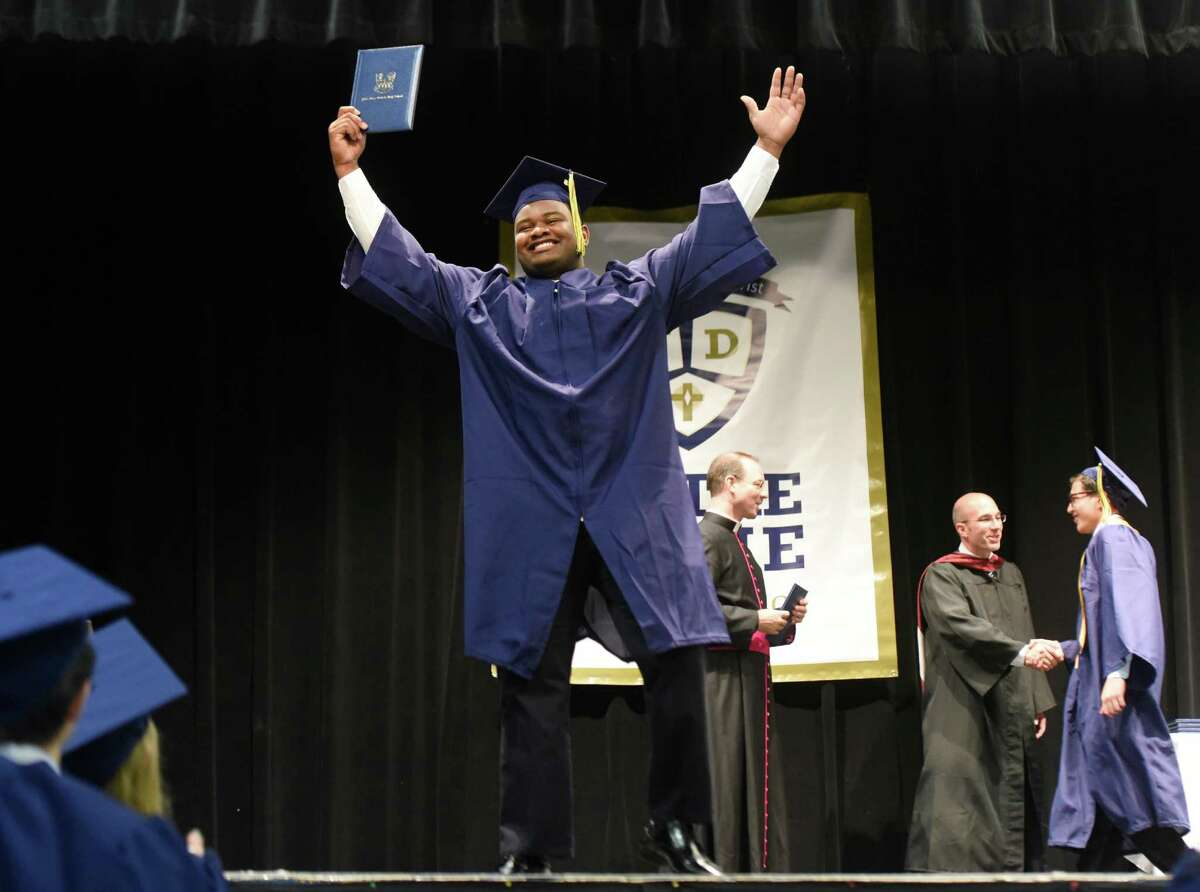 Hakim Fleming, of Bridgeport, celebrates after receiving her diploma at the Notre Dame High School commencement ceremony at Notre Dame High School in Fairfield, Conn. Friday, June 3, 2016.