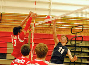 Staples' Kenny Brill, right, goes for a shot during Class L quarterfinal action against Conard on Friday.