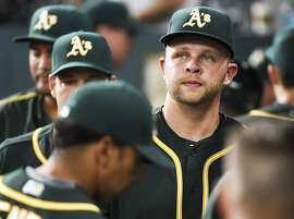 Oakland Athletics starting pitcher Jesse Hahn, right, walks in the dugout after the being pulled from a baseball game during the first inning against the Houston Astros, Friday, June 3, 2016, in Houston. (AP Photo/Eric Christian Smith)