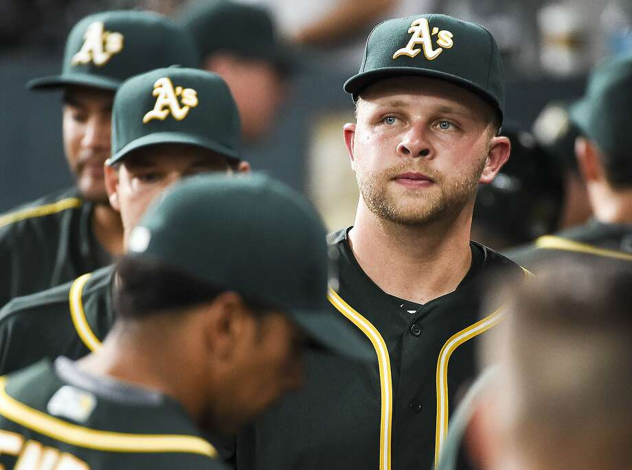Oakland Athletics starting pitcher Jesse Hahn, right, walks in the dugout after the being pulled from a baseball game during the first inning against the Houston Astros, Friday, June 3, 2016, in Houston. (AP Photo/Eric Christian Smith) Photo: Eric Christian Smith, Associated Press
