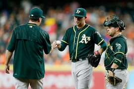 HOUSTON, TX - JUNE 03: Jesse Hahn #32 of the Oakland Athletics hands the ball to manager Bob Melvin as he leaves the game in the first inning against the Houston Astros at Minute Maid Park on June 3, 2016 in Houston, Texas.  (Photo by Bob Levey/Getty Images)