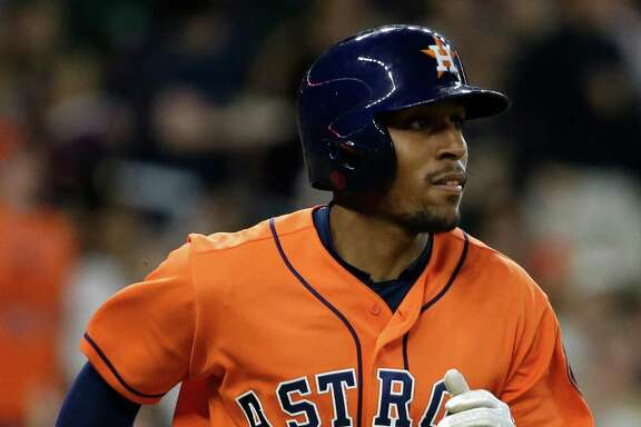Houston Astros Tony Kemp runs on his triple hit against the Oakland Athletics during the first inning of MLB game at Minute Maid Park Friday, June 3, 2016, in Houston.