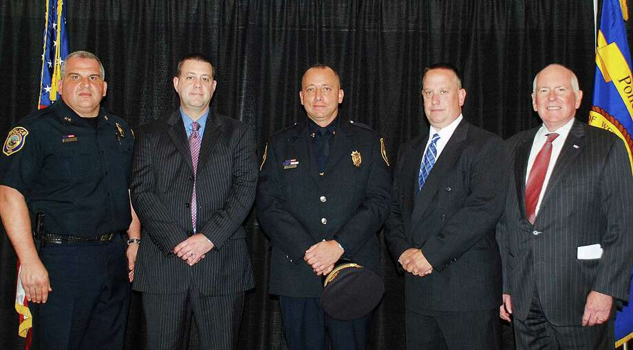From the left to right, Chief of Police Foti Koskinas, Officer Robert Cole, Sergeant David Librandi, Officer Joseph Velky, and First Selectman Jim Marpe. Photo: Contributed / Contributed Photo / Westport News