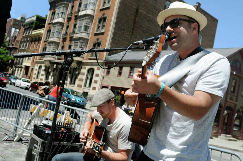 Musician Anthony Fallacaro, right, performs during Art on Lark on Saturday, June 6, 2015, in Albany, N.Y. (Cindy Schultz / Times Union)