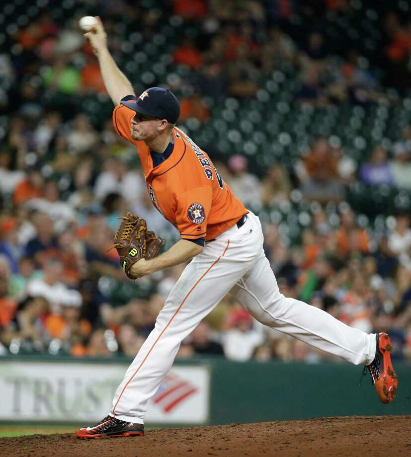 Houston Astros Chris Devenski pitches against the Oakland Athletics during the eighth inning of MLB game at Minute Maid Park Friday, June 3, 2016, in Houston. Photo: Melissa Phillip, Houston Chronicle / © 2016 Houston Chronicle