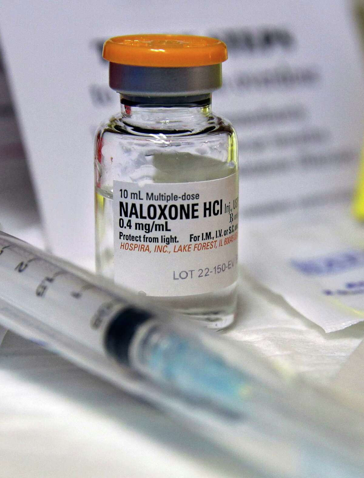FILE- In this Wednesday, Feb. 19, 2014, file photograph, a small bottle of the opiate overdose treatment drug, naloxone, also known by its brand name Narcan, is displayed at the South Jersey AIDS Alliance in Atlantic City, N.J. It is becoming easier for friends and family of heroin users or patients abusing strong prescription painkillers to get access to naloxone, a powerful, life-saving antidote, as state lawmakers loosen restrictions on the medicine to fight a growing epidemic. (AP Photo/Mel Evans, File) ORG XMIT: NYBZ501