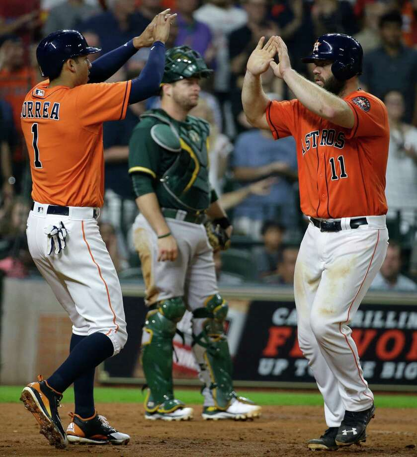 June 3: Astros 12, Athletics 2Houston Astros Carlos Correa, left, and  celebrates with Evan Gattis after his home run against the Oakland Athletics during the fourth inning of MLB game at Minute Maid Park Friday, June 3, 2016, in Houston. Carlos Correa scored on home run hit by Evan Gattis. Photo: Melissa Phillip, Houston Chronicle / © 2016 Houston Chronicle