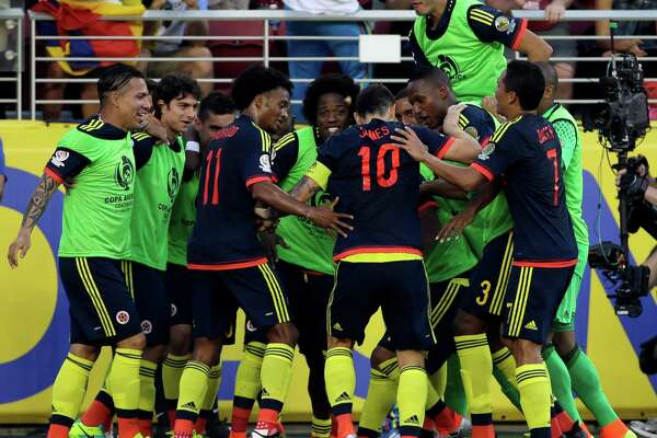 Colombia's James Rodriguez, center, celebrates with teammates after scoring a penalty kick against the U.S. during the opening match of the Copa America Centenario at Levi's Stadium in Santa Clara, Calif., Friday, June 3, 2016.