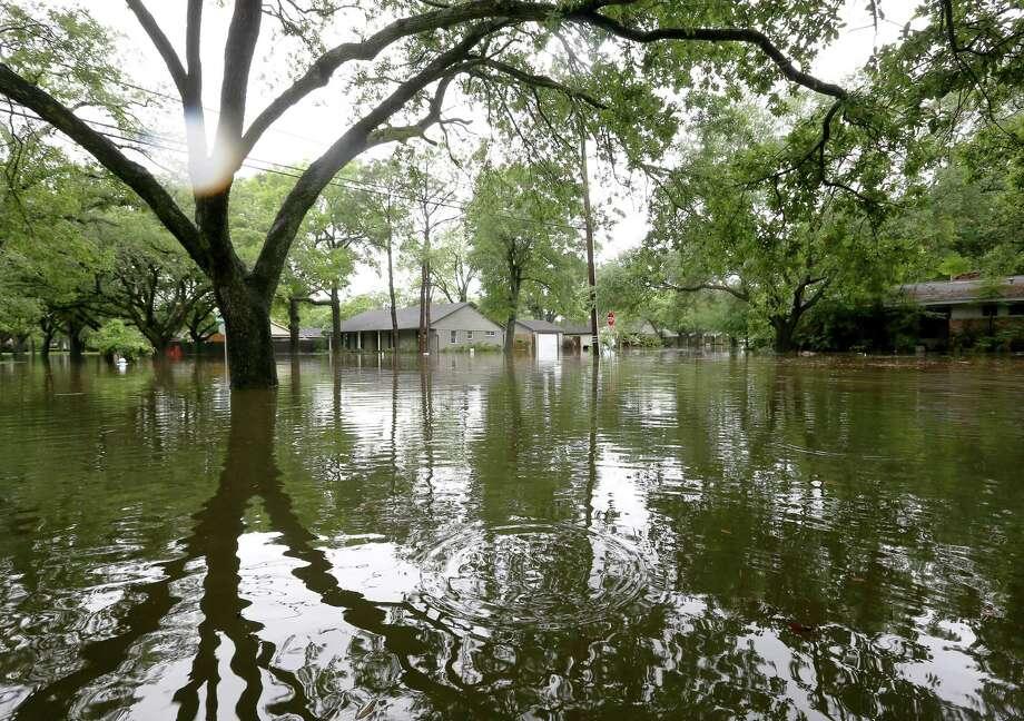 Flooding along Runnymeade Drive, in the Meyerland area, is seen Monday, April 18, 2016, in Houston.  ( Jon Shapley / Houston Chronicle ) Photo: Jon Shapley, Staff / © 2015  Houston Chronicle