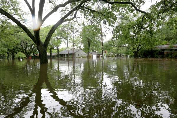 Flooding along Runnymeade Drive, in the Meyerland area, is seen Monday, April 18, 2016, in Houston.  ( Jon Shapley / Houston Chronicle )