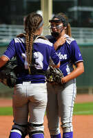 Angleton freshman pitcher Aaliyah Garcia, right, gets some re-assurance from Wildcat junior catcher Briana Cantu during the bottom of the 4th inning of their Class 5A semifinal matchup with Gregory-Portland at the 2016 UIL Softball State Championships at McCombs Field in Austin on Friday, June 3, 2016. (Photo by Jerry Baker/Freelance)
