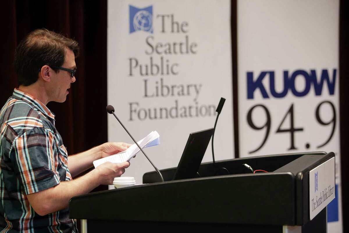 KUOW's Josh McNichols moderates a community discussion on the Jungle homeless encampment, Friday, June 3, 2016 at the Seattle Public Library. About 400 people attended and 900 more were following along online.