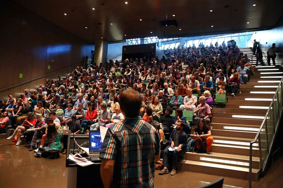 KUOW's Josh McNichols moderates a community discussion on the Jungle homeless encampment, Friday, June 3, 2016 at the Seattle Public Library. About 400 people attended and 900 more were following along online.  (Genna Martin, seattlepi.com)