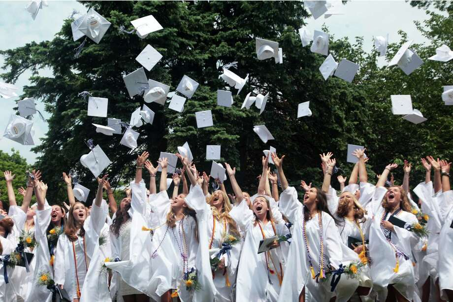 Graduates toss their mortarboards after the Lauralton Hall commencement ceremony in Milford, Conn. on June 4, 2016. Photo: BK Angeletti, For Hearst Connecticut Media / Connecticut Post freelance B.K. Angeletti