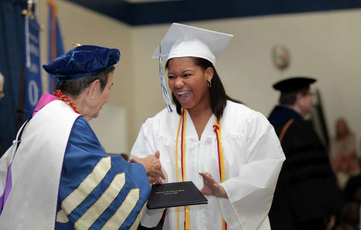 Graduate Lauren Butler, of Bridgeport, reacts during the Lauralton Hall commencement ceremony in Milford, Conn. on June 4, 2016.