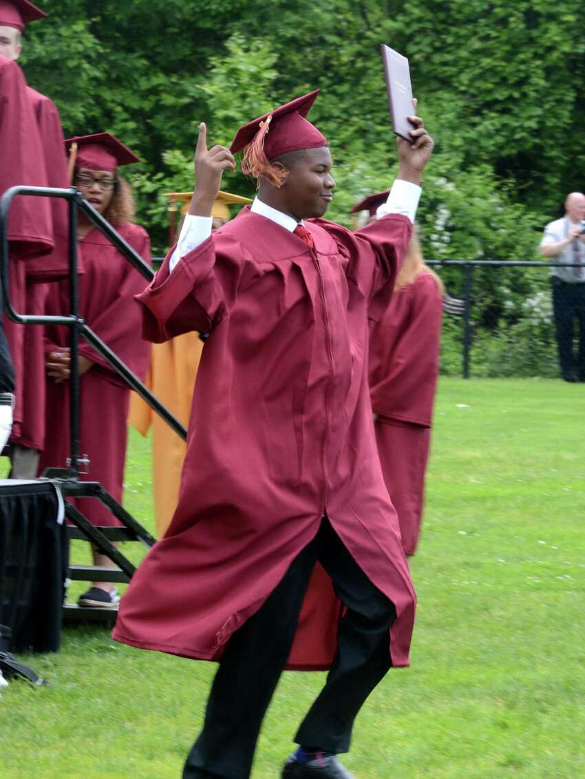Myles Antoney Gee breaks out in dance on his way back to his seat after receiving his diploma. St. Josephs High School in Trumbull, Conn. Graduation ceremony took place at their campus on Sat. June 4, 2016.
