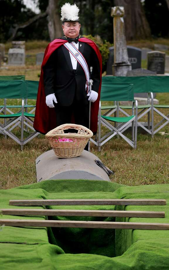 Ruben Manalo with the Knights of Columbus, Yerba Buena Lodge of San Francisco takes a moment at the gravesite before the the reburial of Edith Howard Cook, the girl from the 1800's whose body and coffin were found under the floor of an San Francisco home. The ceremony taking place at the Greenlawn Memorial Park Cemetery in Colma, California on Sat. June 4, 2016. Photo: Michael Macor, The Chronicle