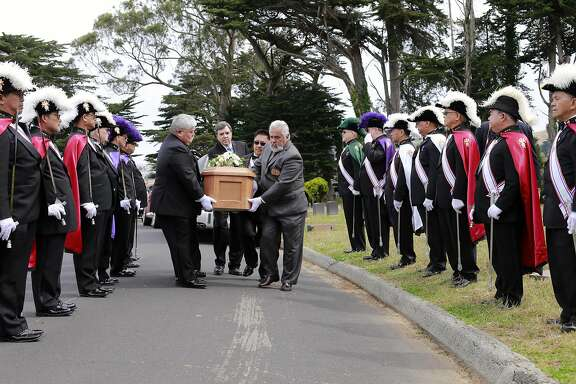 The Knights of Columbus, Yerba Buena Lodge of San Francisco stand guard as the casket is moved to the gravesite during the reburial of Edith Howard Cook, the girl from the 1800's whose body and coffin were found under the floor of an San Francisco home. The ceremony taking place at the Greenlawn Memorial Park Cemetery in Colma, California on Sat. June 4, 2016.