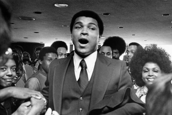 03/02/1975 - Fans greet Muhammad Ali at the airport in Houston