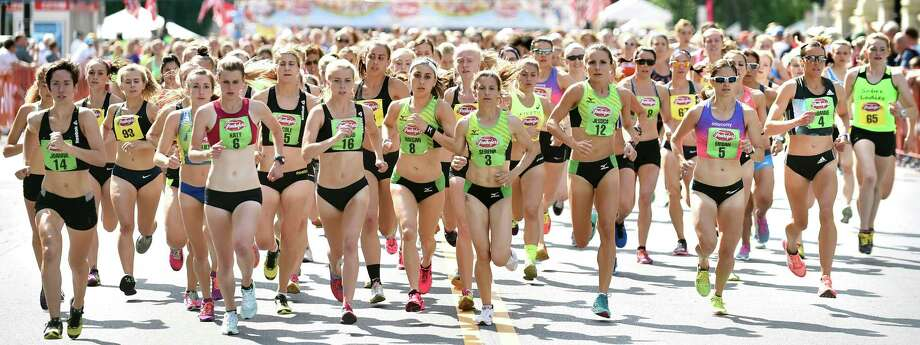 Elite runners lead the field up Washington Avenue during Freihofer's 38th Run for Women on Saturday, June 4, 2016, in Albany, N.Y. (Cindy Schultz / Times Union) Photo: Cindy Schultz / Albany Times Union