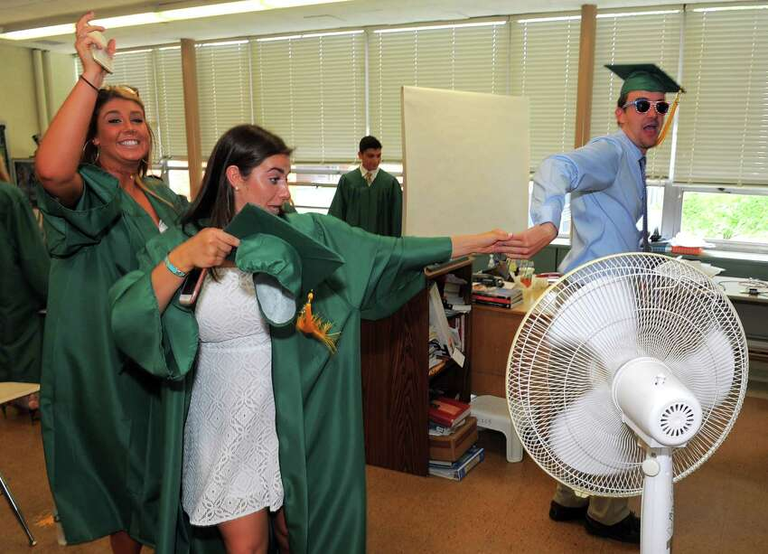 Hannah Davis, Leah Zarrilli and Johnny Somers dance listening to music prior to Trinity Catholic High School Class of 2016 commencement at the school in Stamford, Conn., on Saturday, June 4, 2016.