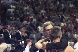 FILE � Chicago Bulls Coach Phil Jackson with Steve Kerr after winning his fifth NBA Championship at the United Center in Chicago, June 13, 1997. Kerr, now the Golden State Warrior�s second-year coach, played on the Bulls team whose win record the Warriors surpassed, another juggernaut that had to beat back a conference finals challenge. (Michelle V. Agins/The New York Times)