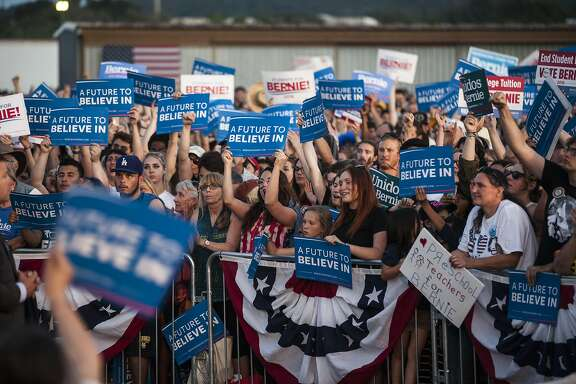 FAIRFIELD, CA - JUNE 03: Supporters of Democratic presidential candidate, U.S. Sen. Bernie Sanders (D-VT) cheer during a campaign rally at Cloverdale Municipal Airport on June 3, 2016 in Cloverdale, California. Five States including California will hold the final Super Tuesday primaries next week. (Photo by Ramin Talaie/Getty Images)