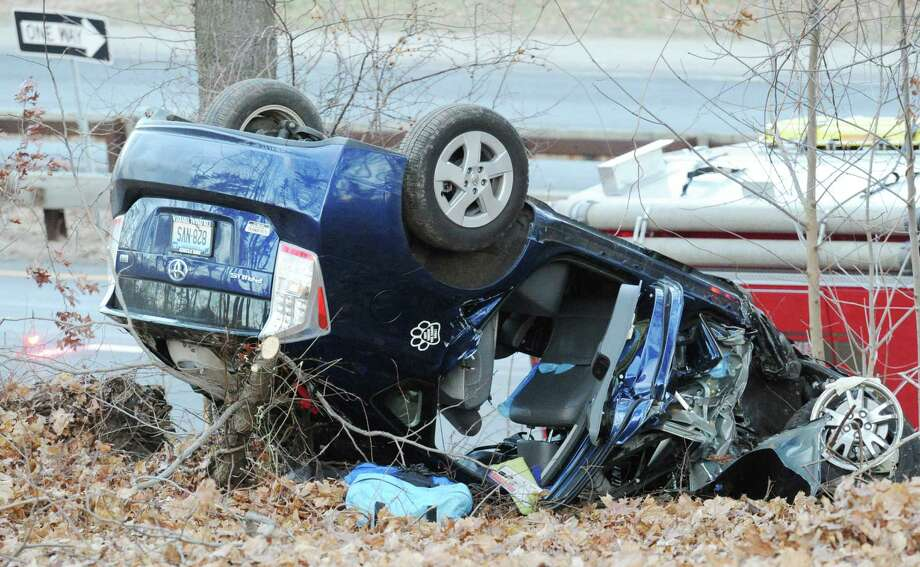 The scene of a rollover of one vehicle in the southbound lane near exit 27 of the Merritt Parkway in Greenwich, Conn., Friday afternoon, Jan. 2, 2015. Photo: Bob Luckey / Bob Luckey / Greenwich Time