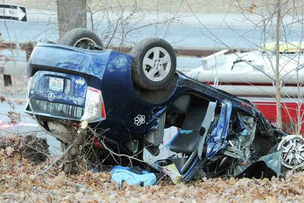 The scene of a rollover of one vehicle in the southbound lane near exit 27 of the Merritt Parkway in Greenwich, Conn., Friday afternoon, Jan. 2, 2015.