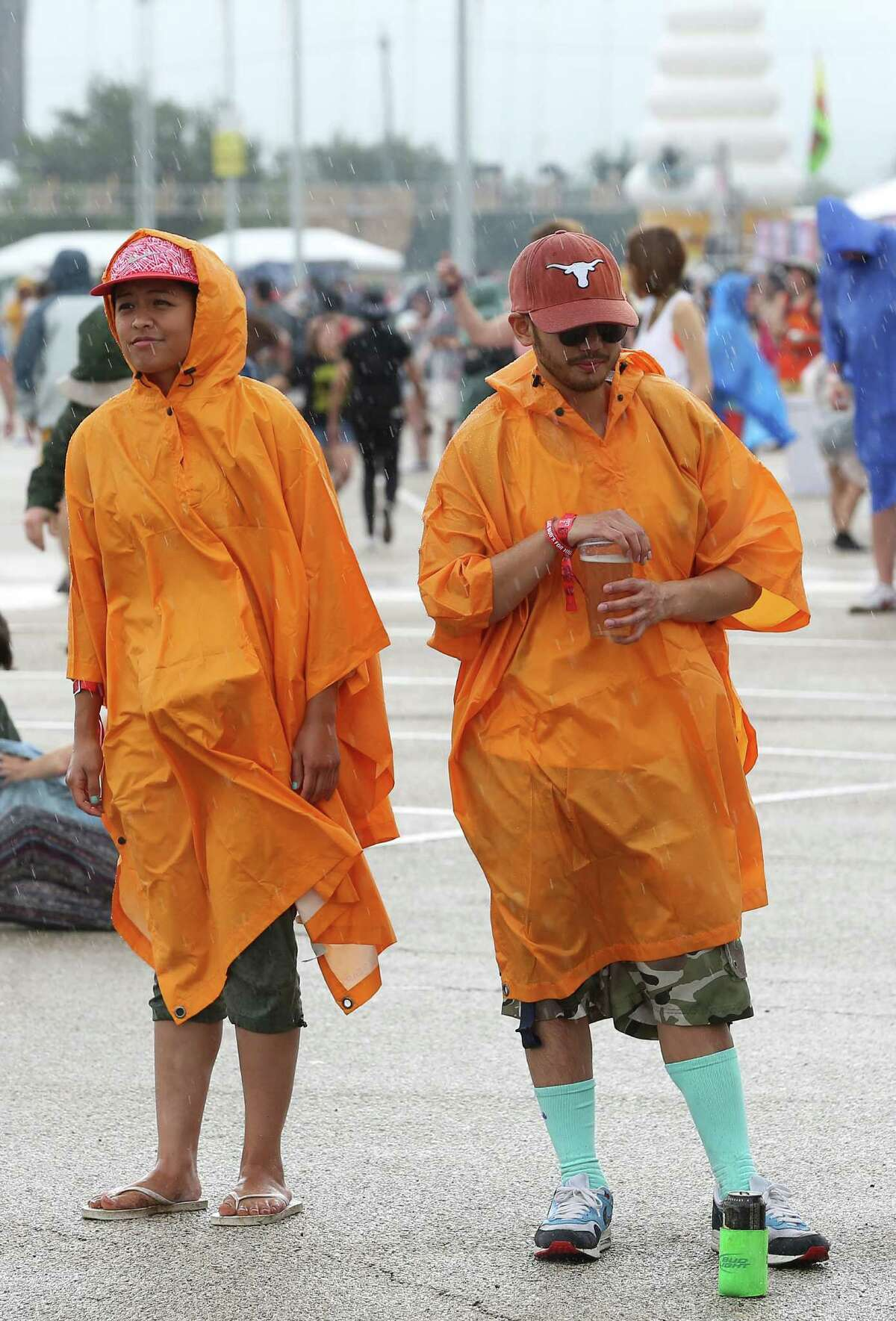 Ira Perez, left, and Miles Machon, stand in the rain at Free Press Summer Fest, at NRG, Saturday, June 4, 2016, in Houston.