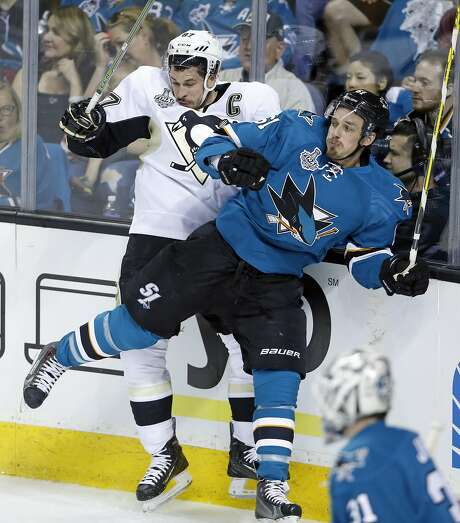 San Jose Sharks' Justin Braun checks Pittsburgh Penguins' Sidney Crosby during 1st period in Game 3 of NHL Stanley Cup Final at SAP Center in San Jose, Calif., on Saturday, June 4, 2016. Photo: Scott Strazzante, The Chronicle