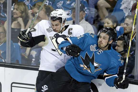 San Jose Sharks' Justin Braun checks Pittsburgh Penguins' Sidney Crosby during 1st period in Game 3 of NHL Stanley Cup Final at SAP Center in San Jose, Calif., on Saturday, June 4, 2016.